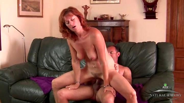 Mature redhead rides cock