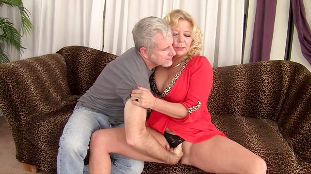 Hot mature gets energized by a man's huge dong